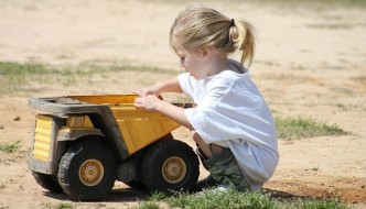 Girl Playing with Truck