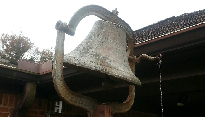 Bell outside the church
