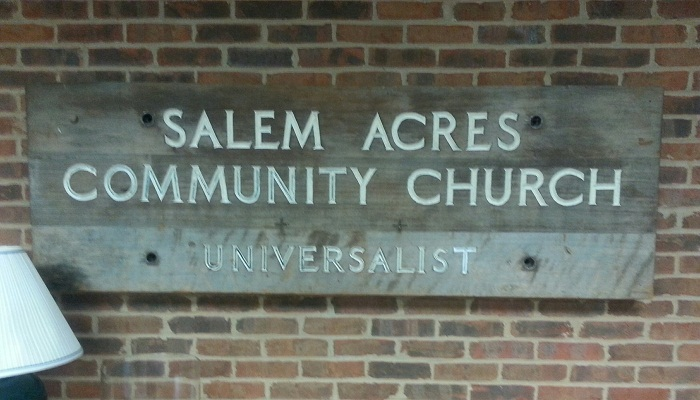 "Wooden sign that says ""Salem Acrees Community Church: Universalist"""