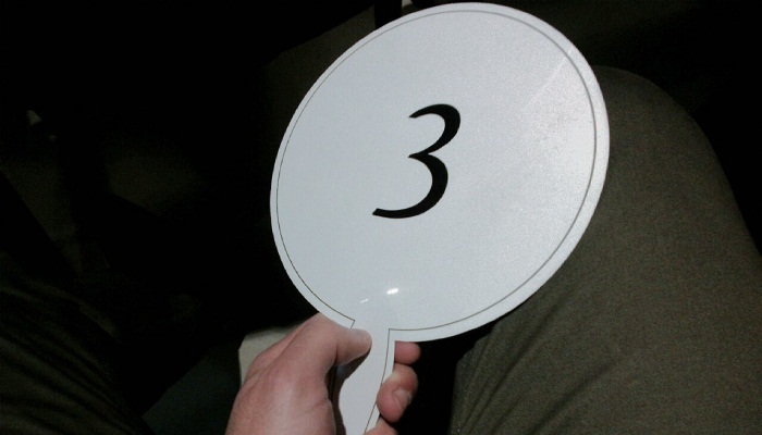 """Auction paddle with the number """"3"""""""