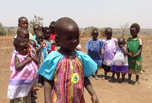African children wear dresses from the Little Dresses organization.