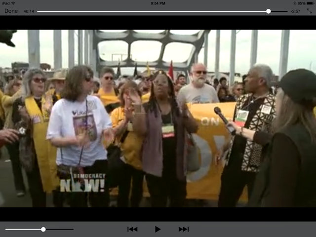 Screen capture from a Democracy Now video. Amy Goodman is interviewing folks on the Edmund Pettus Bridge in Selma, Alabama, in March 2015.