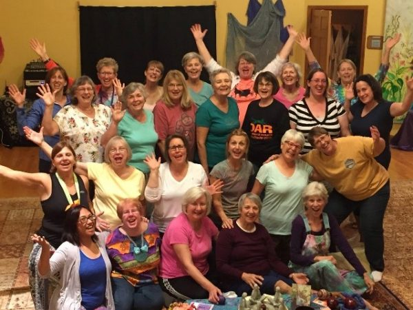 Group photo of 25 women on retreat, all smiling, some raising their hands in celebration.