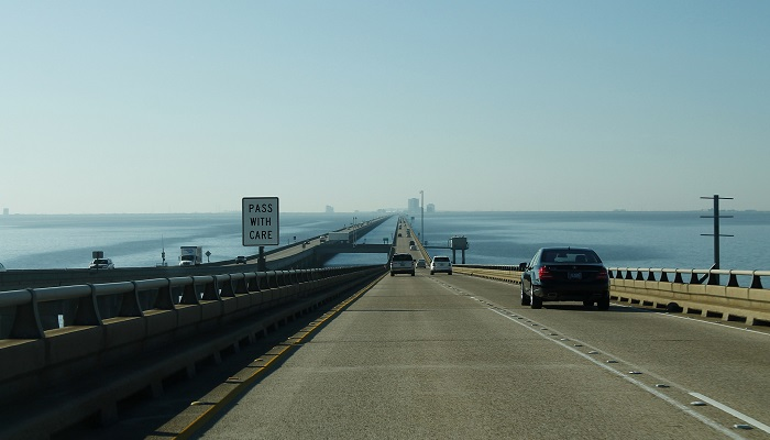 Lake Pontchartrain Causeway South: Image of looking down a road that goes over a long bridge over water.