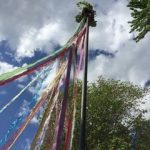May Pole: Pole with ribbons streaming down.