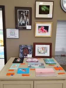 Wall and countertop showing many pieces of art.