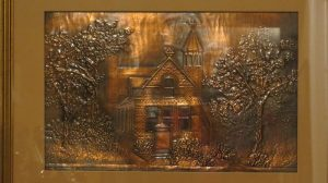 Copper sheet hammered to form a raised image of the Essex Street Church