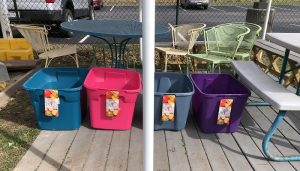 Four plastic donation bins lined up behind Heritage UU Church